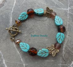 Turquoise leaf and glass beads with butterfly spacers.