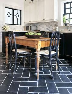 like the use of black and white here--  black tile and white grout, black used on bottom half of kitchen with white walls and upper cabinets keep it from being too dark