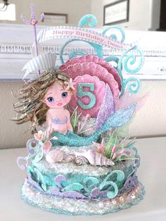 Custom Child Mermaid, Pink Sea Shell, Under the Sea, Birthday Cake Topper... This precious mermaid sends birthday wishes as she plays in her undersea paradise! A custom birthday cake topper, art piece – Handmade with every attention to detail. Packaged in a lovely gift box, tied with a satin bow.