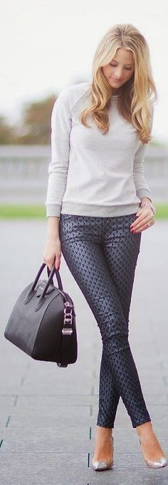 Cute work outfit. Neutral sweater and print trousers.
