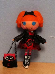 Lalaloopsy mini custom doll in hand made red dress and jacket.