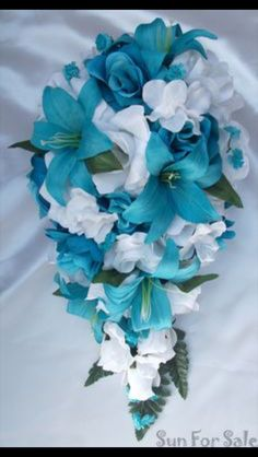 Beautiful Tiffany blue lily bouquet!