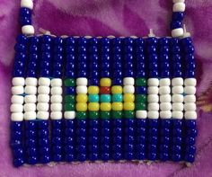 A personal favorite from my Etsy shop https://www.etsy.com/listing/452004460/el-salvador-pride-beaded-flag-necklace
