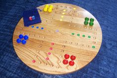 Aggravation game large marbles for up to 4 players, made from solid oak harwoods on Etsy, $79.95. Large marbles easier for elderly people and kids