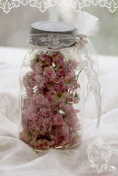 Shabby sweetness simply by placing dried petals in a jar, then wrapping with lace