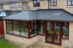 A new class of conservatory, perfect for many applications. A beautiful GardenRoom can extend your living area and is ideal for dining and entertaining, but equally comfortable as a study. House Extension Design, Extension Designs, Built In Bedroom Cabinets, Warm Roof, Living Area, Living Spaces, Conservatory Extension, Porch Addition, Hip Roof