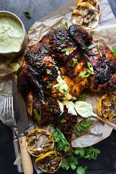 Spatchcocked Grilled Chicken by The Modern Proper. Rubbed down with a smoky, sweet spice blend, and served with creamy, garlicky herb sauce, this grilled spatchcocked chicken is hands down the best darn recipe we've ever dreamt up. Spatchcock Chicken Grilled, Spatchcocked Chicken Recipe, Grilled Whole Chicken, Butterflied Chicken, Stuffed Whole Chicken, Tandoori Chicken, Best Grill Recipes, Grilling Recipes, Cooking Recipes