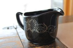 Black amethyst glass creamer with silver overlay. $20.00, via Etsy.