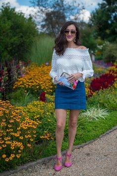 Feminine summer outfit ideas for women. Wearing a white off the shoulder top from Anthropologie and a denim mini skirt from Free People. Accessorize with a floral clutch http://baublestobubbles.com/2017/08/30/how-to-style-a-floral-clutch/?utm_campaign=coschedule&utm_source=pinterest&utm_medium=Olivia%20Johnson%20-%20Baubles%20to%20Bubbles&utm_content=Floral%20Paradise