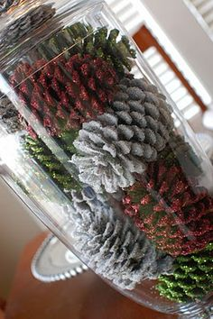 Major vision over here: pinecones... spray paint white or silver. Bling up with glitter. Put in glass vase as center piece! Perfect for my white holiday party! Maybe add some scrapbook diamond blings to this project.