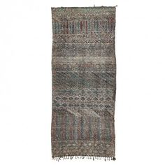 Vintage Moroccan Wool Rug   Woven by the nomadic tribes of the Atlas Mountains, this vintage Moroccan wool rug features allover geometric motifs in deep, earthen hues.
