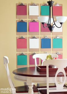 Madigan Made { simple DIY ideas }: Large Clipboard Wall Décor  Oh my gosh, totally LOVE this idea!!!! I am definitely doing this in my bedroom with pictures!!!!!!!!!!