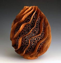 Bud Latven often uses exotic species of wood in his lofty, segmented and turned, geometric forms. The play on positive and negative space allows light to pass through the sculpture resulting in shadows.