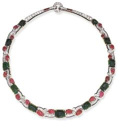 """A RARE ART DECO EMERALD, RUBY AND DIAMOND """"TUTTI FRUTTI"""" NECKLACE, BY CARTIER The articulated band designed as a pavé-set diamond undulating branch, with black enamel trim, enhanced by carved ruby leaves and carved emerald berries, to the tapered old European-cut diamond backchain, with calibré-cut ruby accents, mounted in platinum, circa 1925, 14 ins. Signed Cartier, No. 238"""