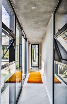 This contemporary farm house was designed around a central courtyard to create privacy. An ode to the farmhouse design, incorporating glass and steel. Indoor Outdoor, Outdoor Living, Farmhouse Design, Bay Window, Facade, Entrance, Pergola, Stairs, Contemporary