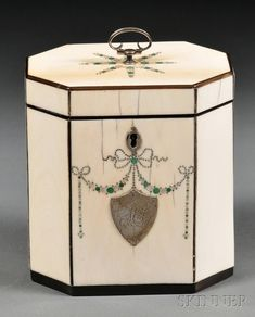 Octagonal Ivory Tea Caddy, England, late 18th century, trimmed with tortoiseshell and with a silver knob and monogrammed shield-shaped cartouche, green shell, mother-of pearl and silver pique work to the front and top panels.