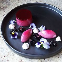 Blackberry panacotta meringue and pansy