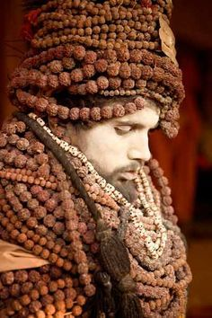 Kumbha Mela pilgrim - by Jean-Marc Giboux - the necklace/bead as protective device; Hindus believe this bead (made from the seed of the Rudaksha tree) will help one's spirit ascend higher and closer to the secrets of the cosmos.
