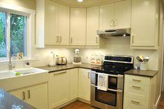 Adele off white cabinets with white backsplash tile