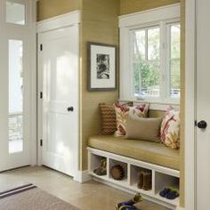 mud room area in foyer- bigger window, bench seat, lift top seat for shoes, hidden closet