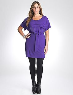 With a versatile length that works as a top or short dress, we love the pleated detail on this fun tunic! In a soft knit to wear in any weather, this statement piece layers perfectly over leggings or tights. Flattering scoop neck and tie belt make the most of your curves.  lanebryant.com