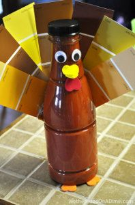 I love crafts that use paint samples! This Paint Chip Turkey is a super easy Thanksgiving craft for kids to make, and it costs next to nothing! | AllFreeKidsCrafts.com