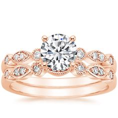 This is the prettiest ring I've ever seen. 14K+Rose+Gold+Tiara+Matched+Set+from+Brilliant+Earth
