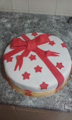 Irish Christmas fruit cake with homemade marzipan and iced with fondant and tied with fondant now.
