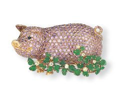 Pink diamond piggy brooch by Carvin French.