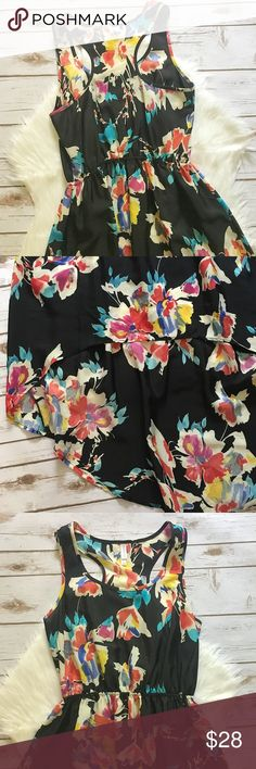 """Floral Hi-Low Maxi Dress Floral high-low maxi dress. Racerback. Elastic waist. Unlined. 100% Polyester. All measurements on one side when laid flat: Length from top of shoulder to hem about 39"""" in front; 55"""" in back. About 15.5"""" from top of shoulder to waist. Underarm to underarm about 16"""". Worn gently several times and in excellent condition. Xhilaration Dresses High Low"""