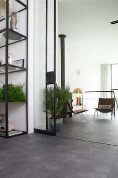5 Concrete Floors That Will Cement Your Love for This Material - NY Homes Inc Grey Flooring, Black Floor Tiles, Concrete Floors, Contemporary Living Room Design, Flooring, Concrete Floors Living Room, Concrete Floors In House, Pvc Flooring, Vinyl Flooring