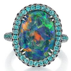 October Birthstone The OPAL ~ One-of-a-kind platinum ring featuring a 9.66cts Australian Lightning Ridge Black Opal, 0.87cts t.w. Paraiba tourmalines, 1.53cts t.w. sapphires and 0.76cts t.w. diamonds by OMI PRIVE