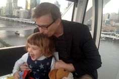 Photo Nigel with his daughter, aged 3, on a ferris wheel in Brisbane.
