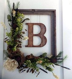 Beautiful rustic floral monogram wreath door decor!