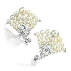A pair of platinum earrings with natural pearls and diamonds, by Bhagat. Platinum and diamond leaf earrings, by Bhagat. @virenbhagat #bhagatjewels  #elegantjewelry @fd_gallery