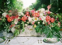 Outdoor floral centerpiece design with pink peonies | Anne Robert Photography | see more on: http://burnettsboards.com/2014/03/dreamy-abandoned-mansion-inspiration-shoot/