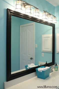 Structural Fixture: Strip Lighting This Provides General Lighting For The  Bathroom, As Well As Accent Lighting For The Framed Mirror.