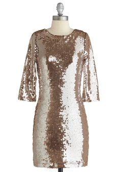 Very Dynasty, all I need is a turban, some red patent heels and a glass of Champagne!  Sparkling Toast dress from Modcloth