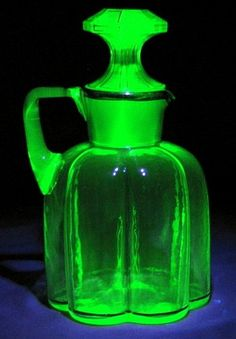 Glass infused with uranium. The uranium gives the glass a distinct green glow. This is a decanter from the 1840s.
