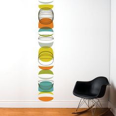 """Zanzibar mid-century modern graphic decal by Mia & Co. Adhesive vinyl, claims easy to remove. 78"""" tall x 8"""" wide. $35 retail, but $24 on TouchOfModern flash sales site .... Sept 2012"""