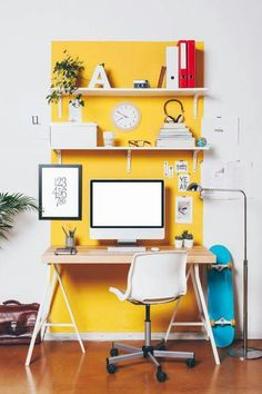 From Architectural Digest Unify a work area by painting the space. This yellow creates the workspace and delineates the space.   Lauren B Montana