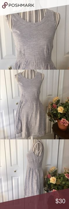 """🌹ANTHROPOLOGIE LILKA swing skirt dress w/pockets This Anthropologie """"Lilka"""" sleeveless dress is 100% stretchy grey cotton with side smocked elastic for a very comfortable and sweet look.  Side slit pockets in the swing skirt are closed with pink buttons!  Size S, measures approximately 16 inches pit to pit, 14 inches across elastic waist and 34 inches shoulder to hem.  EUC. Normal hand wash wear. No stains, holes, rips. Anthropologie Dresses"""