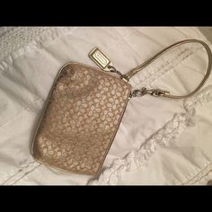 Coach wristlet Small gold coach wristlet and perfectly new condition Coach Bags Clutches & Wristlets