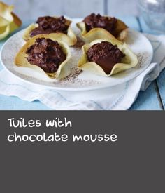 Tuiles with chocolate mousse |      Mary Berry's recipe for tuiles shapes these French wafer biscuits in three ways – decorated curves, chocolate-dipped cigars and a basket that can be filled with chocolate mousse.Equipment and preparation: You will need a template for shaping the tuiles mixture before baking. You can buy these, or try making one by cutting circular holes in a sheet of silicone or plastic.