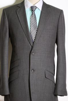 Two button, grey pinstripe suit with change pocket
