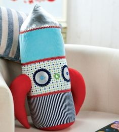 Our irresistible retro-style pillow would make a great accessory for a space-themed bedroom. The cylindrical shape has been created using a bolster Bolster Cushions, Diy Pillows, Sewing For Kids, Baby Sewing, Sewing Patterns Free, Free Sewing, Diy Rocket, Fluffy Pillows, Toy Rooms
