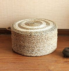 Natural cattail pouf with sponge filling.