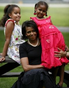 First Lady Michelle Obama and First  Daughters, Malia and Sasha.