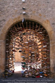 """Installation Art © Jay REYMOND (Artist, Switzerland). Photo ©Thomas GUIGNARD via flickr.  """"24 heures du livre,"""" 2007 Book Festival,  Romainmôtier, Switzerland. Medieval Arch. Suspended Books ... The law requires you to credit the artist. Link directly to artist's website.  HOW TO FIND the ORIGINAL WEB SITE of an image: http://pinterest.com/pin/86975836525507659/  PINTEREST on COPYRIGHT:  http://pinterest.com/pin/86975836526856889/  The Golden Rule…"""