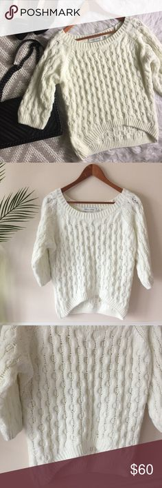Bishop + Young • Off White Sweater Bishop + Young Off-white Sweater   Beautiful knit sweater. Thick/chunky knit. Off-white in color. Quarter length sleeves. Longer length in back. No flaws/excellent condition! Size M. Length: 2/24 inches Bust: 18 inches flat bishop + young Sweaters